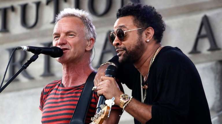 Sting, left, and Shaggy perform before Game 3