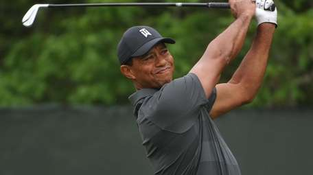 Tiger Woods tees off from the second hole