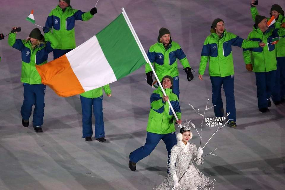 Flag bearer Seamus O'Connor of Ireland leads in