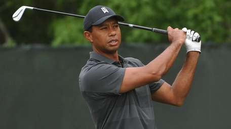 Tiger Woods prepares to tee off from the