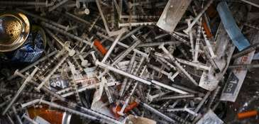 Discarded needles at a heroin encampment in the