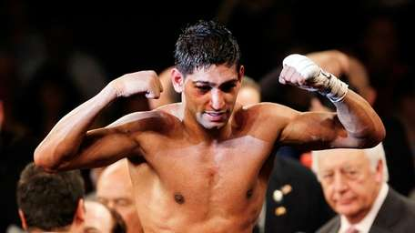 Amir Khan of Great Britain celebrates after defeating