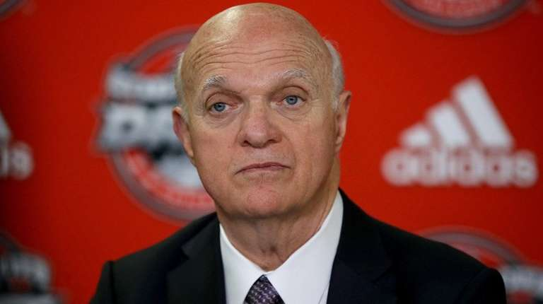 Lou Lamoriello speaks to the media after the