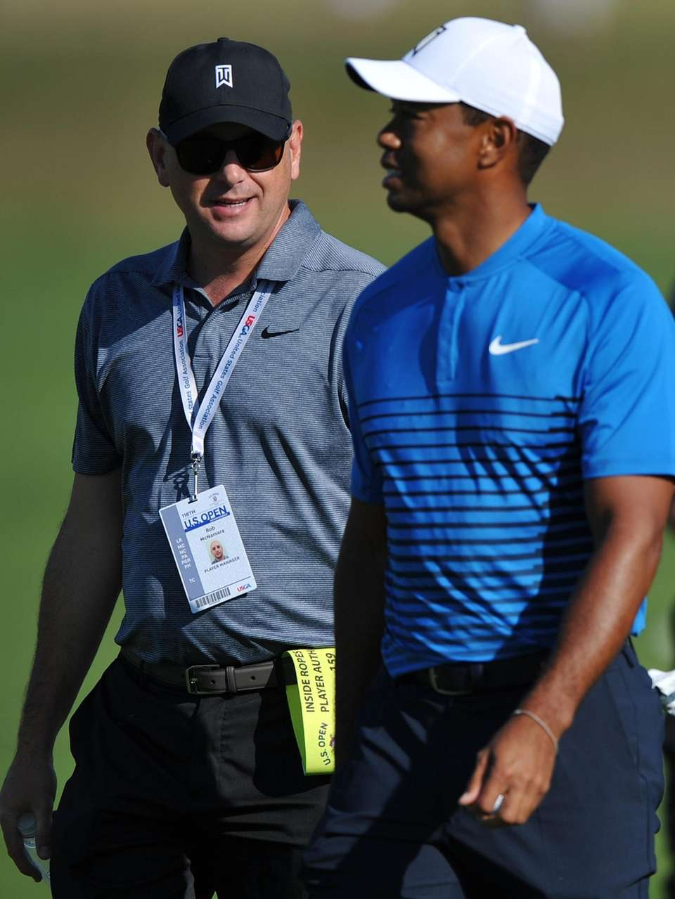 Rob McNamara, player manager, left, paces alongside Tiger