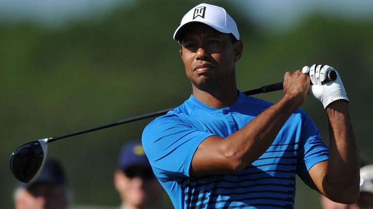 Tiger Woods gets ready to tee off from