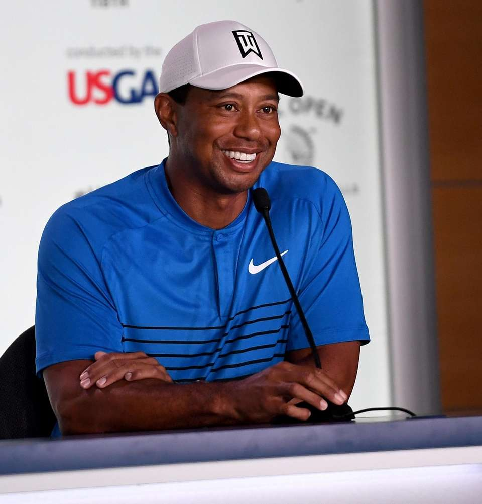 Tiger Woods speaks to the media after a