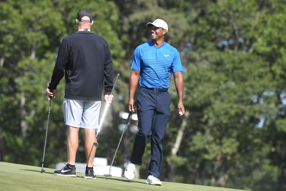 Tiger Woods, right, with his caddy Joey LaCava