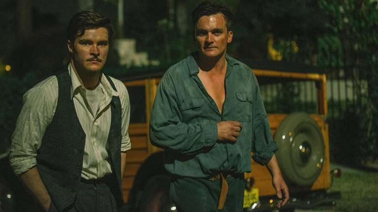 Jack Reynor, left, and Rupert Friend play neighbors