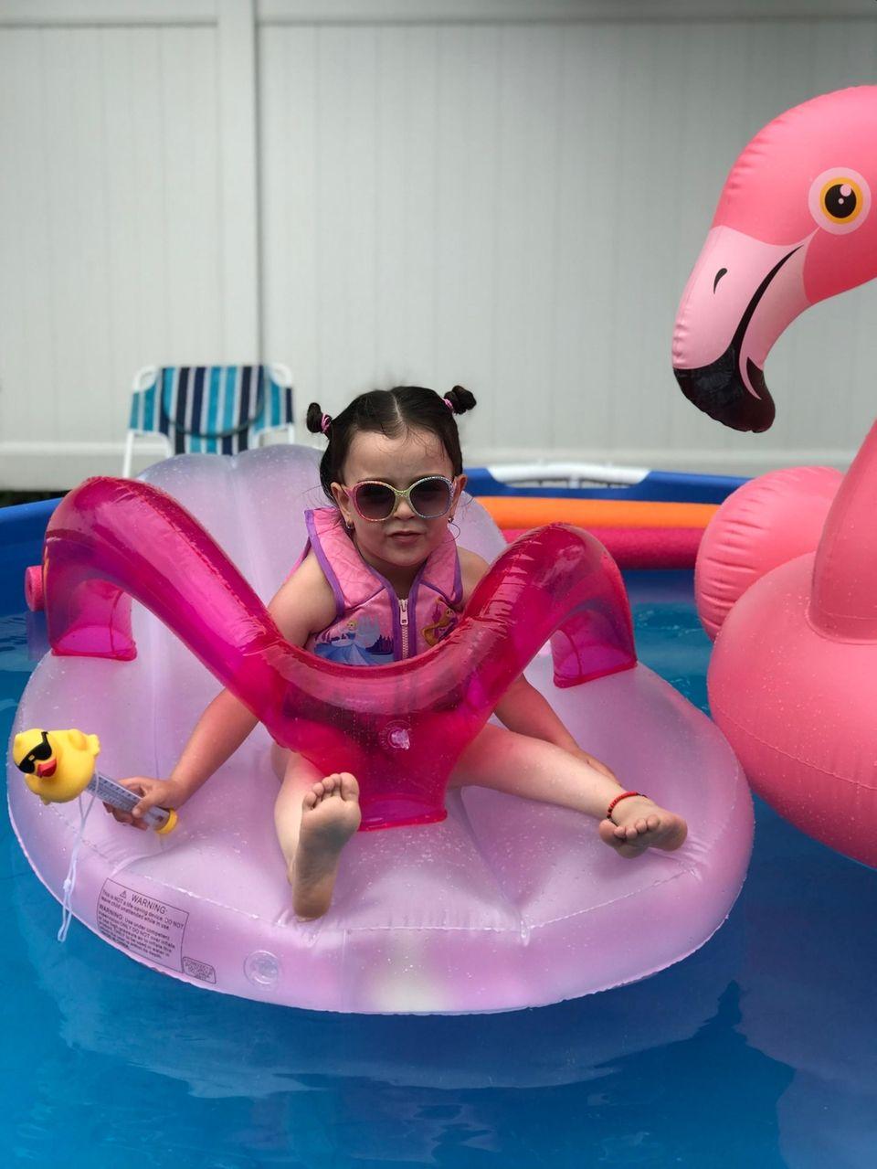Leah irizarry is at her backyard enjoying summer