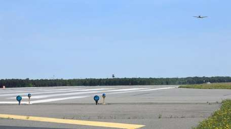 The threshold area of runway 06/24 at Long