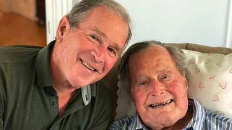 Former Presidents George W. Bush and his father,