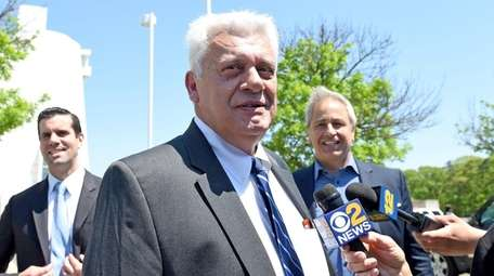 John Venditto leaves court in Central Islip on