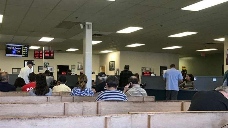 People wait on Tuesday for service at the