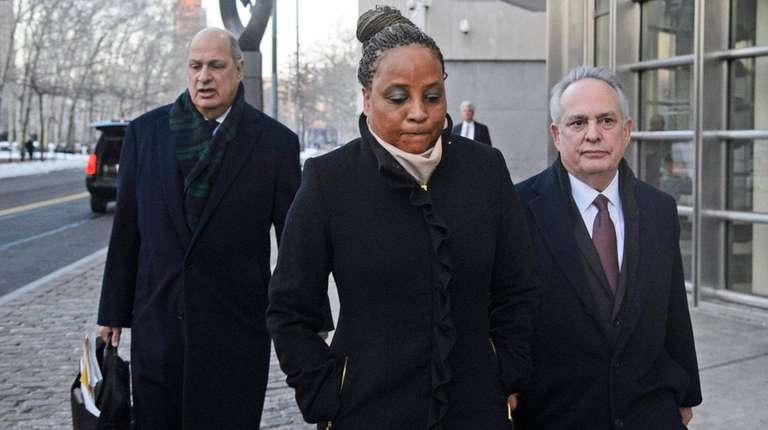 Former Brooklyn Assemblywoman Pamela Harris, center, pleaded guilty