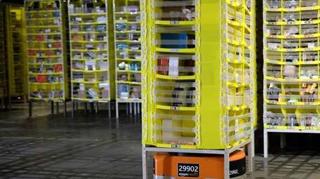 An automated transport robot moves goods in a