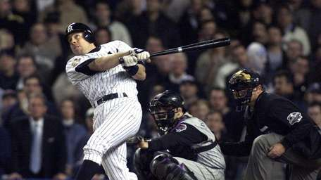 The Yankees' Scott Brosius reacts after hitting a