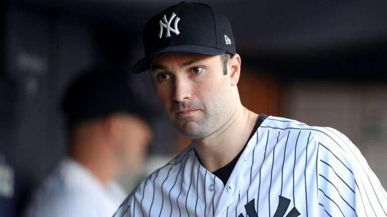 Yankees infielder Neil Walker looks on from the