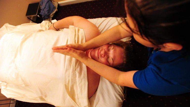 Christina Coke L.M.T. administers a prenatal massage to
