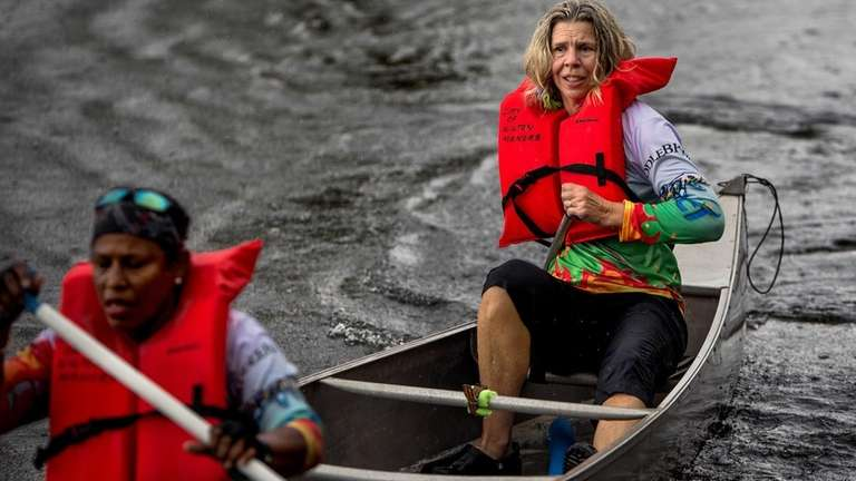 Judy Perkins, right, seen paddling during a team
