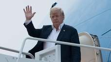 President Donald Trump disembarks Air Force One at