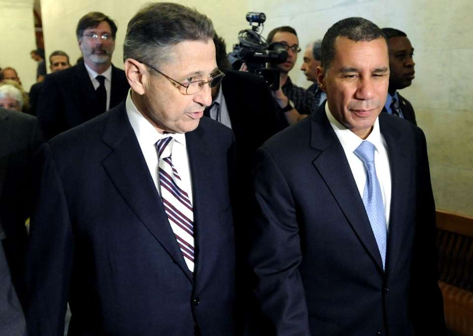 FILE - Gov. David Paterson, right, walks to