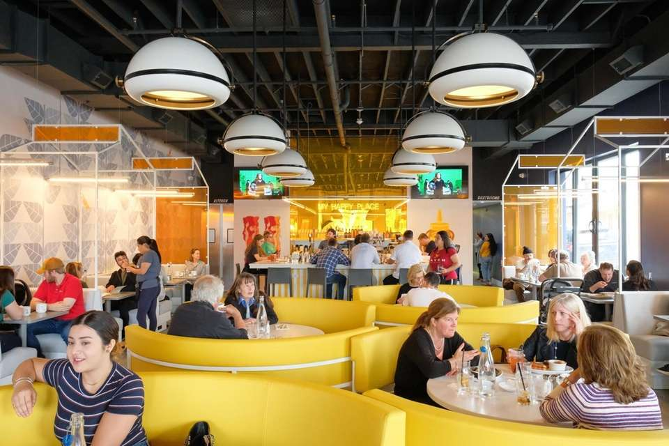 Round, yolk-colored booths offer dramatic seating in the