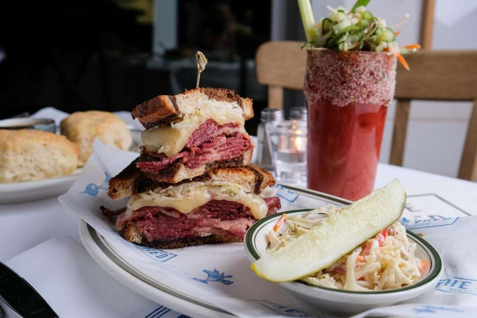 A Reuben sandwich stacked with corned beef, Swiss