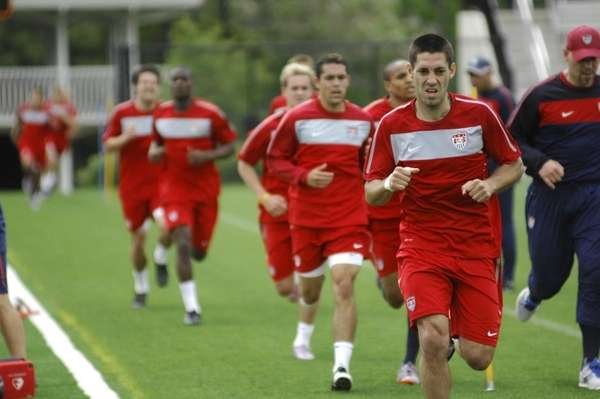 Midfielder Clint Dempsey leads the team during a