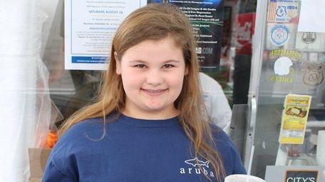 Kidsday reporter Sarah Tonna enjoys a snack at