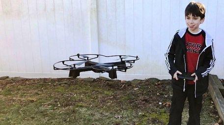 Kidsday reporter Ryan Mener pilots his drone.