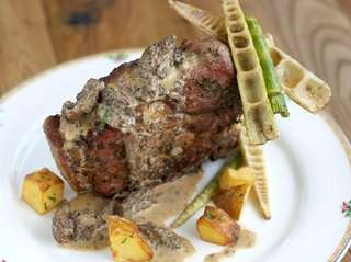 Pork chops with wild morels and bamboo at