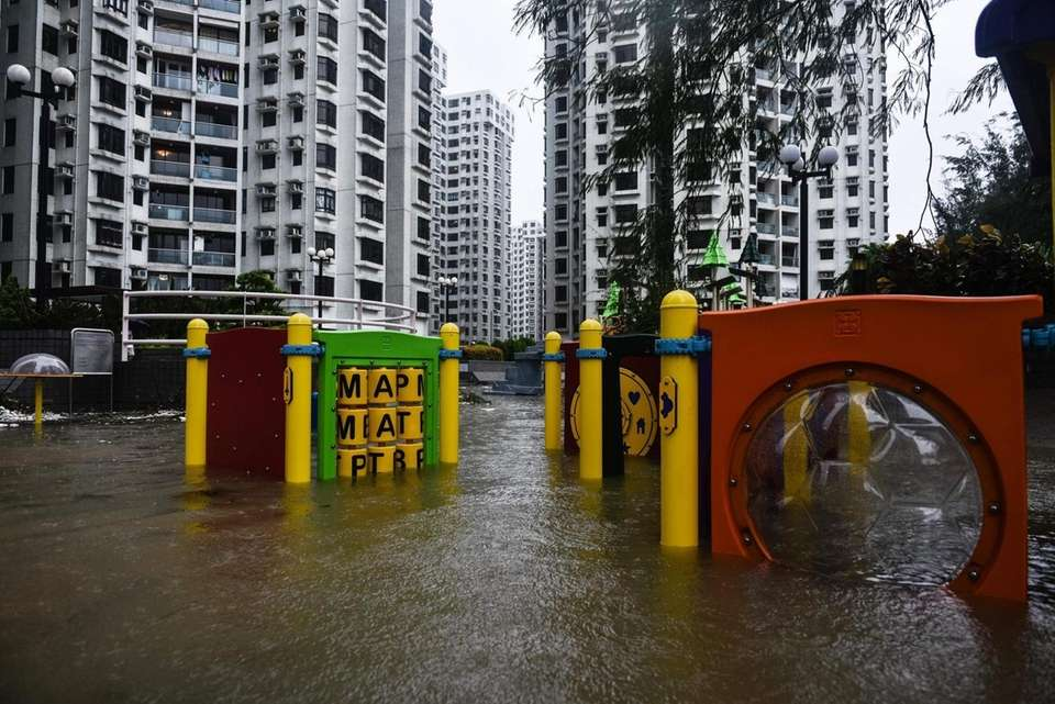 A flooded playground is seen in front of