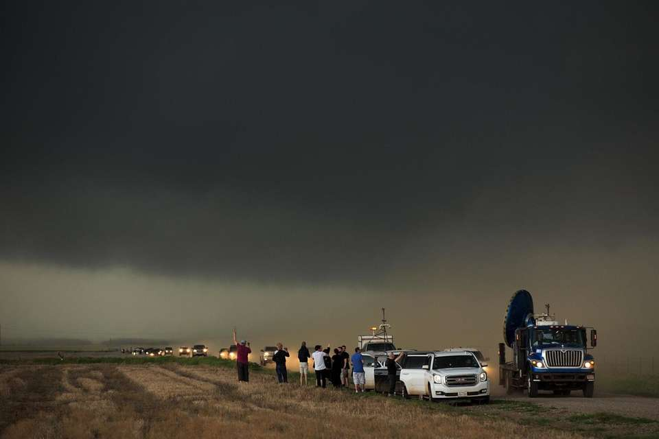 A caravan of storm chasers arrive on the