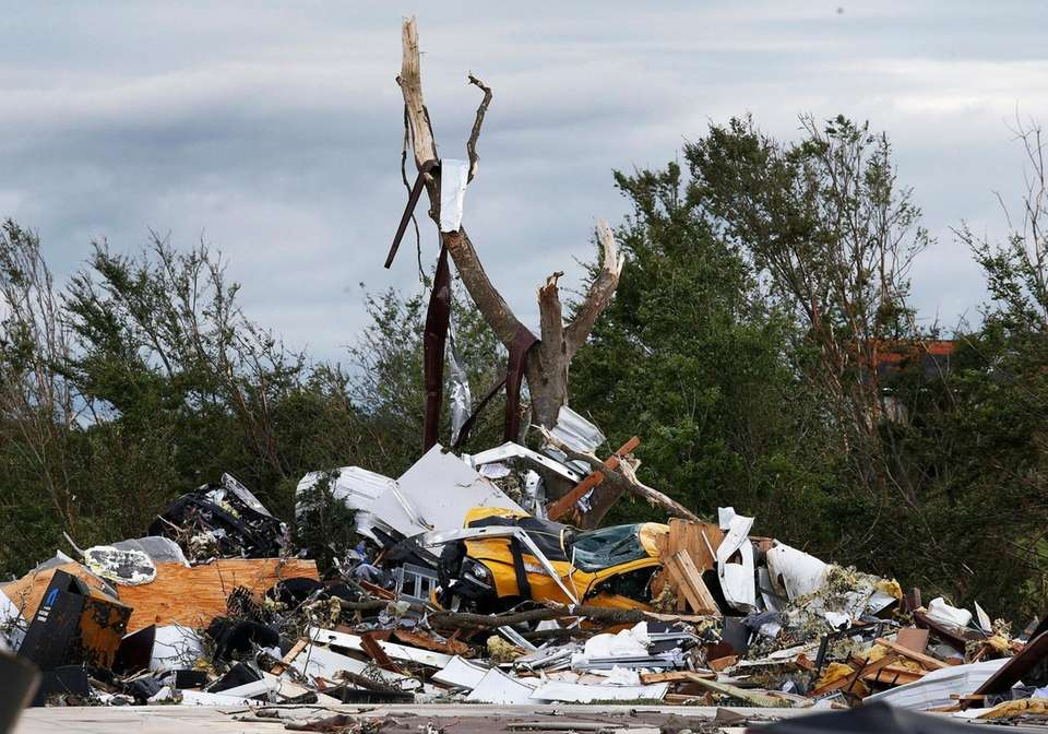 Cars and debris is seen piled up at