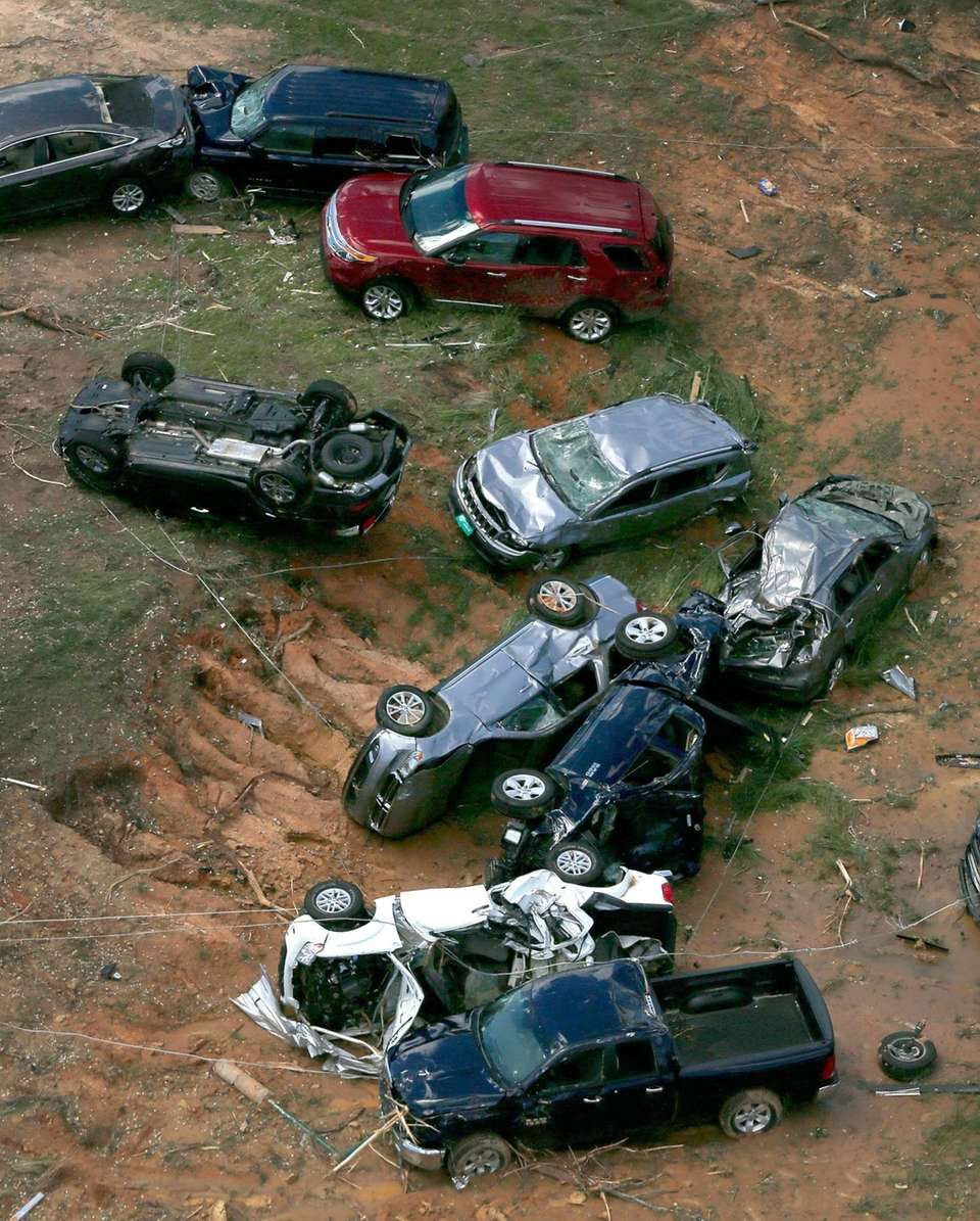 Damaged cars and trucks that were thrown off