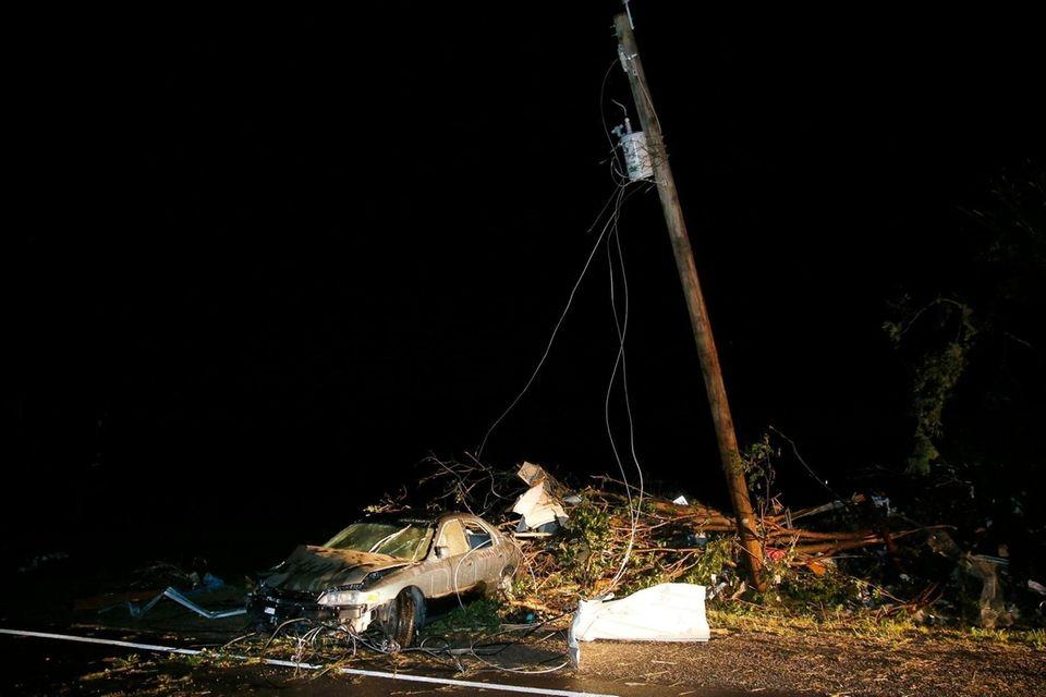A car is part of the tornado debris