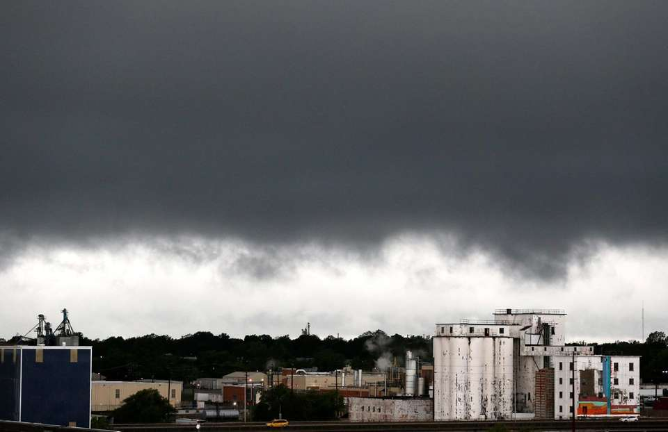 Rain clouds appear over downtown Springfield, Mo., on