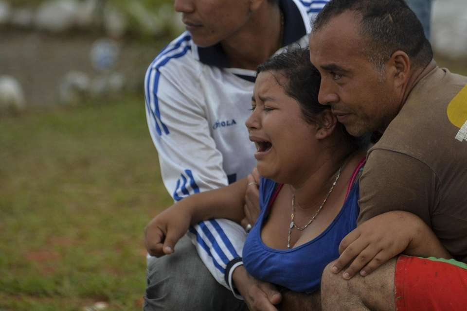 A woman weeps during the funeral of her