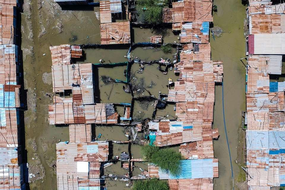 An aerial view of flooded houses at the