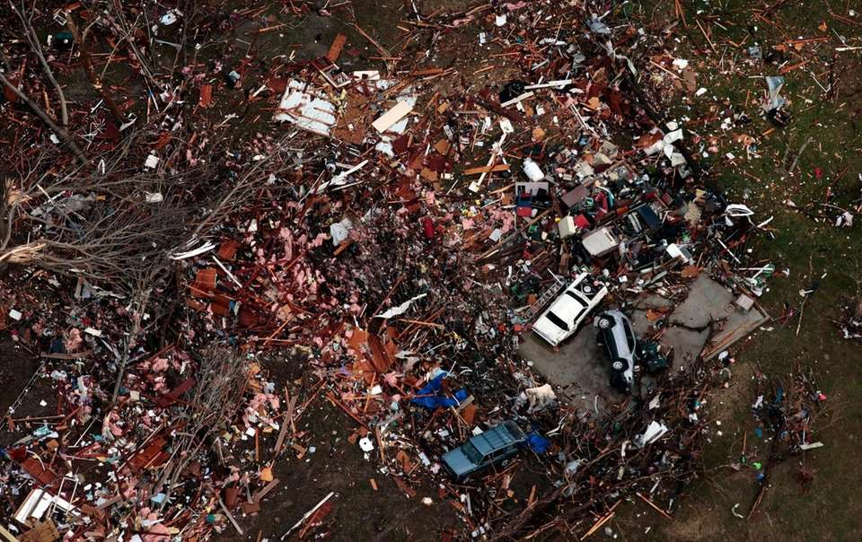 Debris marks the site of a home in