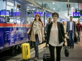 Travelers on the platform of the Nightjet, which