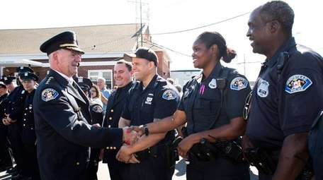 Hempstead Police Chief Michael McGowan, left, retired from
