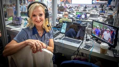 WFAN's Ann Liguori poses from her booth at