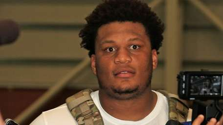 Giants offensive tackle Ereck Flowers speaks to reporters
