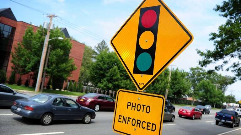 A sign notifying drivers of a red-light camera