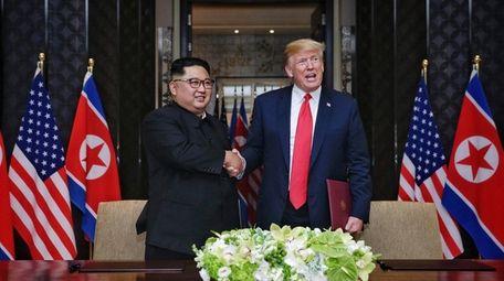 North Korean leader Kim Jong Un shakes hands