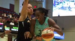 Liberty center Tina Charles tries to drive past