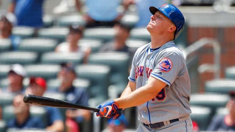 New York Mets' Jay Bruce reacts after popping