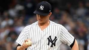 Sonny Gray looks at the ball in the
