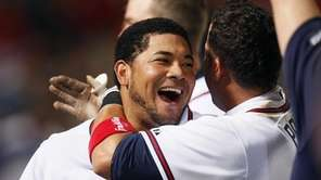 Atlanta Braves' Melky Cabrera, left, celebrates with Martin
